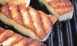 Halloumi cheese frying in grill pan.